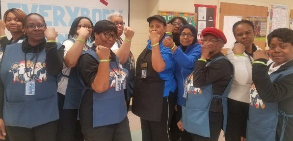 "The staff at Clinton Elementary School in South Orange showing off their ""Start with Hello Bracelets."""